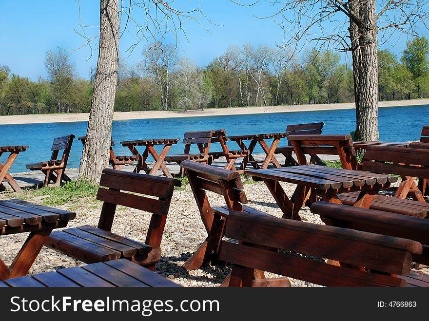 Wooden tables in park