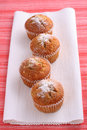 Free Four Cupcakes Muffins On White And Red Place Mats Royalty Free Stock Photo - 4774865