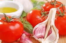 Garlic, Tomatoes And Basil. Royalty Free Stock Photography