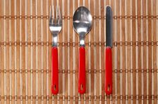 Free Spoon, Fork And Knife On Bamboo Background Royalty Free Stock Photos - 4771288