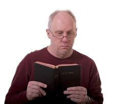 Free Older Man Reading Bible Royalty Free Stock Photography - 4771467