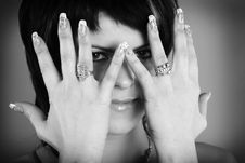 A Woman Takes Her Hand Near Face Royalty Free Stock Photography
