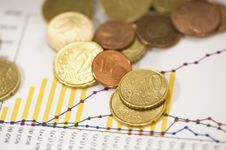 Free Euro Coins On Financial Data Papers Stock Photos - 4777843