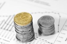Piles Of Euros On Financial Data. Royalty Free Stock Image