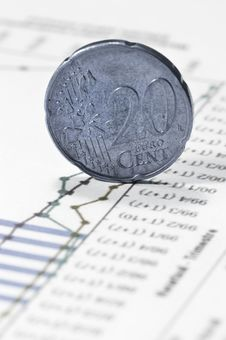 Free Euro Twenty Cent Coin On Financial Data Papers Stock Photo - 4777920