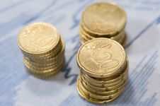 Piles Of Euros On Financial Data. Royalty Free Stock Images