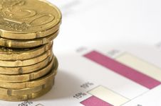 Piles Of Twenty Cents Euros On Financial Data. Stock Photography