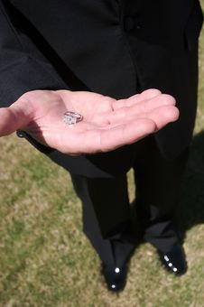 Diamond Ring In The Grooms Hand Before A Wedding Stock Photos
