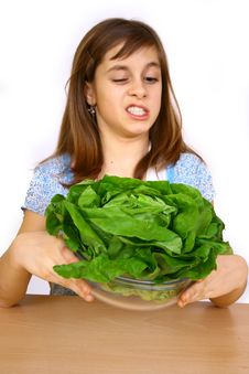 Free Girl Eating A Salad Royalty Free Stock Photography - 4778847