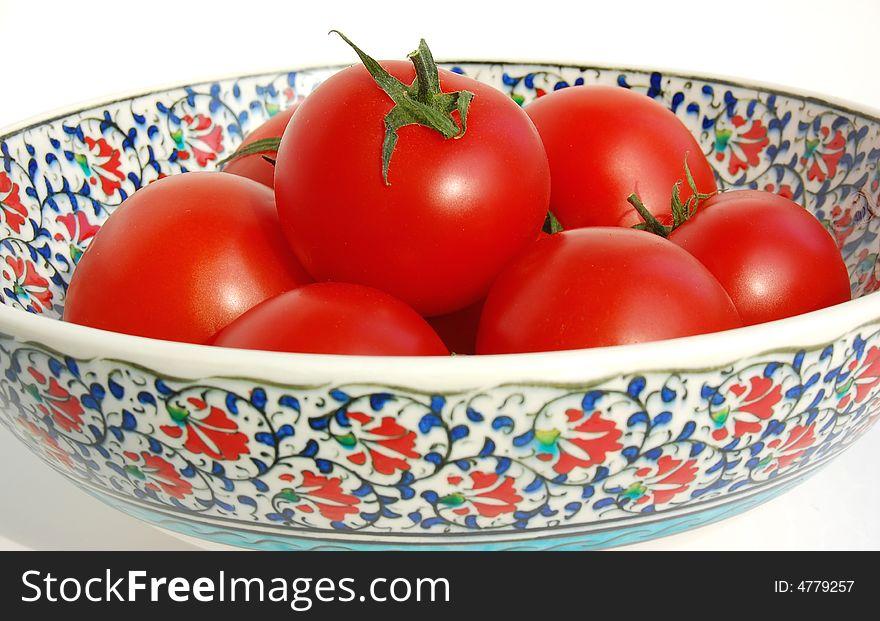 Tomatos in ceramic bowl