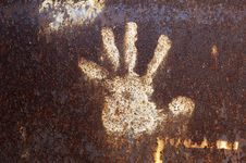 Rusty Metal With Handprint Stock Photo