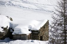 Chalet Under Snow Stock Photo