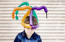 Mad Boy With A Balloon Hat Stock Photography