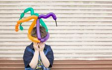 Sad Boy With A Balloon Hat Royalty Free Stock Photography