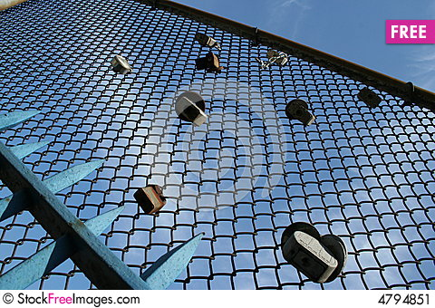 Free Padlocks On A Wire Mesh Stock Image - 4794851