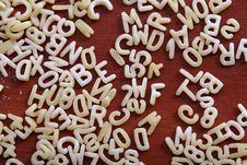Free Eatable Mini Alphabet On Table Stock Photos - 4790403
