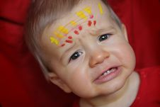 Free Boy With Painted Forehead And Sad Face Stock Photos - 4790793