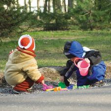 Small Girl And The Boy Play Color Toys At Road (1) Royalty Free Stock Photography