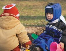 Small Girl And The Boy Play Color Toys At Road (2) Royalty Free Stock Photography