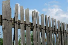Free Old Wood Fence Over A Blue Sky Royalty Free Stock Photography - 4798037