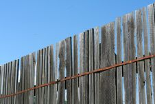 Old Wood Fence Over A Blue Sky Royalty Free Stock Photos