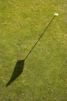 Shadow Of A Golf Flag Stock Photos