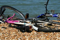 Free Bikes Lying Around On The Beach Stock Images - 4801204