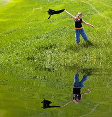 Free Young Woman Playing On Green Field. Stock Image - 4800461
