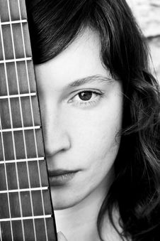 Free Woman Behind Guitar Fretboard Stock Images - 4800554