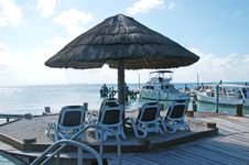 Free Umbrella ,beach Chairs And Boats Royalty Free Stock Image - 4802556