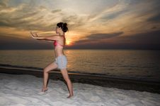Free Woman Doing Yoga By The Sunset Beach Royalty Free Stock Photos - 4808738