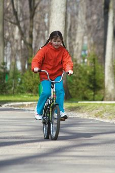 The Girl-teenager On Park On A Bicycle (2) Stock Photos