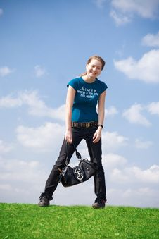 Free The Young Attractive Girl With A Handbag Royalty Free Stock Image - 4811586