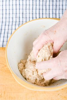 Hands Mixing Dough Royalty Free Stock Images