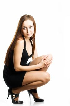 Free Sitting Woman In Black Dress And Tights Royalty Free Stock Images - 4818499