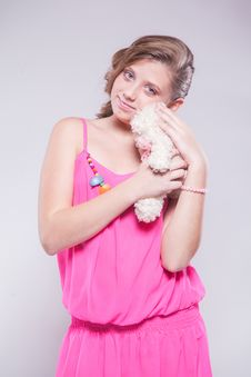 Free Girl In A Pink Dress Holding A Teddy Bear Stock Image - 48175791