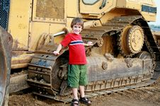 Free Little Boy And Bulldozer Royalty Free Stock Photo - 4821145