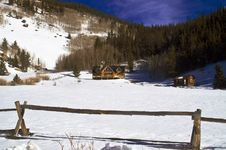 Colorado Mansion Log Home In Snow Stock Photo