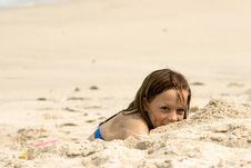 Girl In The Sand Stock Photos