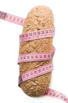 Free Bread Wrapped With A Measurement Tape Royalty Free Stock Images - 4827049