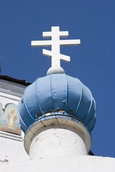 Cross Under The Blue Sky Stock Photo