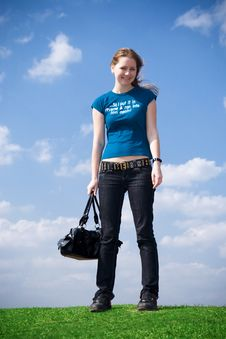 Free The Young Attractive Girl With A Handbag Royalty Free Stock Image - 4827906