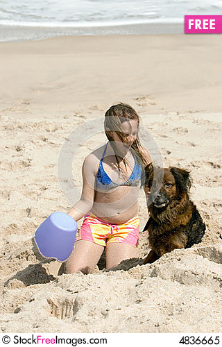 Free Girl In The Sand With Dog Royalty Free Stock Photo - 4836665
