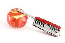 Pocket Knife And Partially Peeled Apple Royalty Free Stock Photo