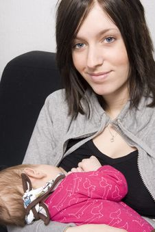 Young Mother With Her Baby Stock Photos