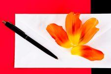 Petals, Pen And An Envelope Stock Photo