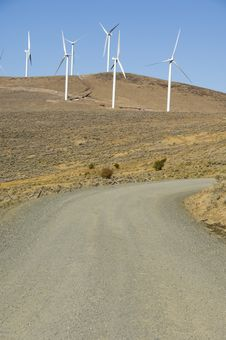 Gravel Road Among Wind Turbines. Stock Photos