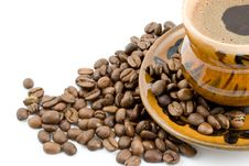 Coffee Beans And Black Coffee In A Cup Stock Images