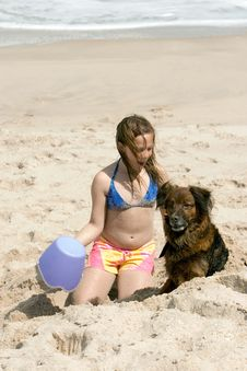 Girl In The Sand With Dog Royalty Free Stock Photo