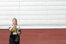 Women With Bunch Of Flowers In City